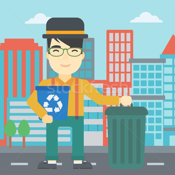 Férfi újrahasznosít tároló szemeteskuka ázsiai fiatalember Stock fotó © RAStudio