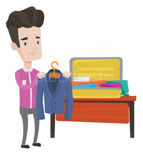 Young man packing his suitcase vector illustration Stock photo © RAStudio