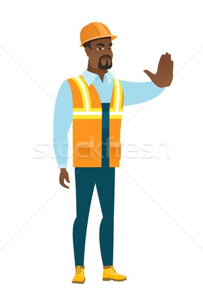 African-american builder showing stop hand gesture Stock photo © RAStudio