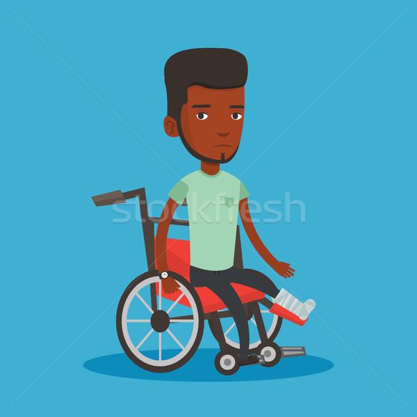 Man with broken leg sitting in wheelchair. Stock photo © RAStudio