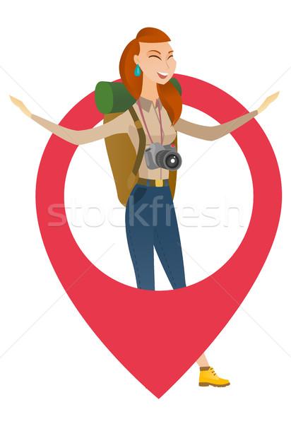 Traveler woman jumping through a big map pointer. Stock photo © RAStudio