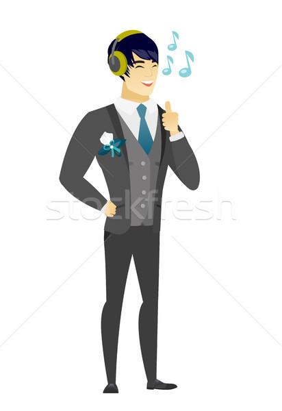 Groom listening to music in headphones. Stock photo © RAStudio