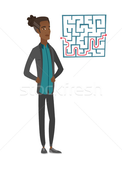 man looking at labyrinth with solution. Stock photo © RAStudio