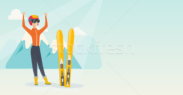 Young caucasian skier standing with raised hands. Stock photo © RAStudio
