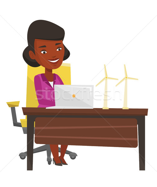 Woman working with model wind turbines. Stock photo © RAStudio