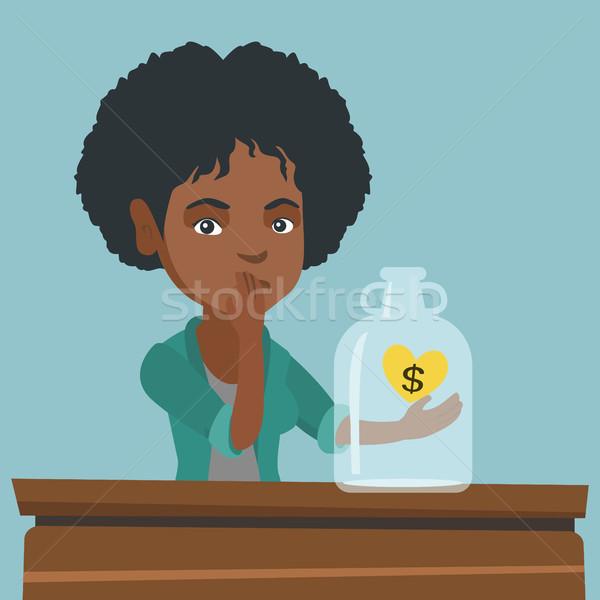 African broke woman looking at empty money box. Stock photo © RAStudio