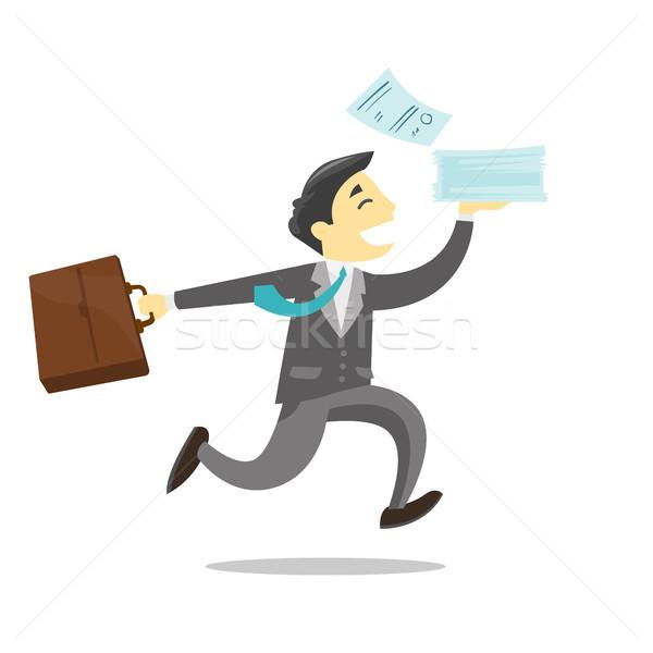 Biznesmen uruchomiony teczki dokumentów młodych Zdjęcia stock © RAStudio