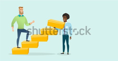 Caucasian businessman runs up the career ladder. Stock photo © RAStudio