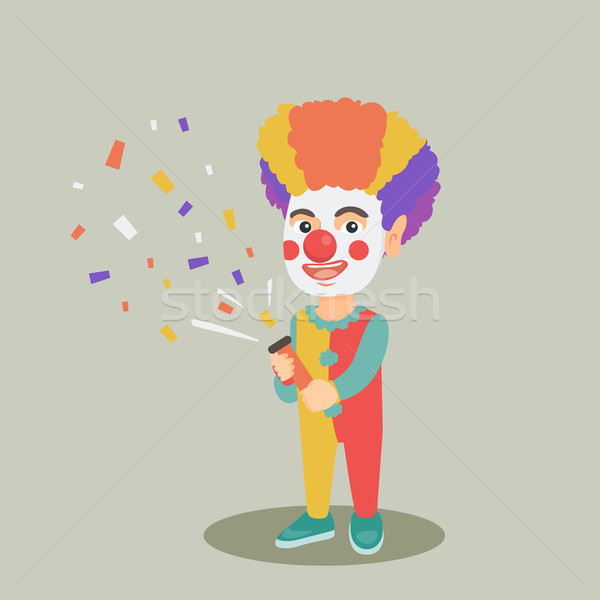 Clown boy shooting a party popper confetti. Stock photo © RAStudio
