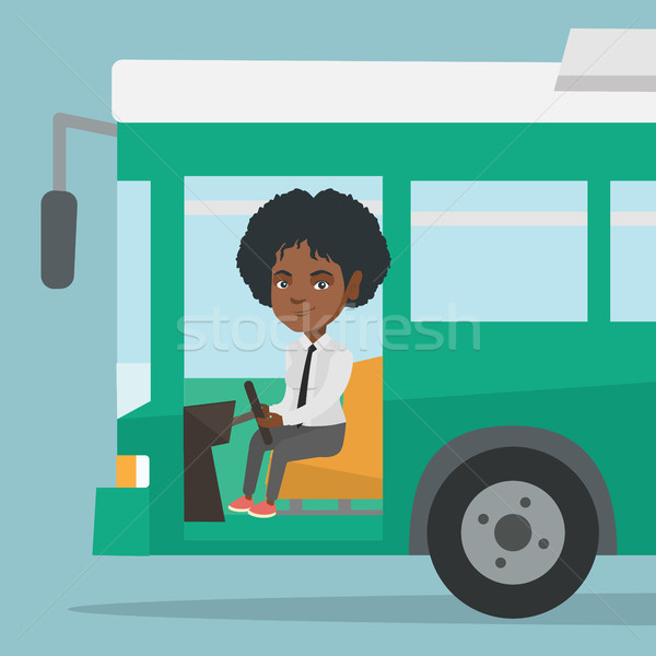 Young african bus driver sitting at steering wheel Stock photo © RAStudio