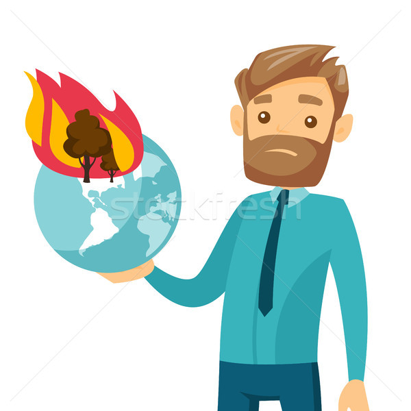 Caucasian man holding globe with forest in fire. Stock photo © RAStudio