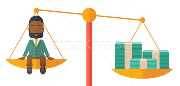 Businessman on a balance scale Stock photo © RAStudio