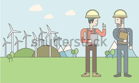 Człowiek panele słoneczne kask tabletka ręce Zdjęcia stock © RAStudio