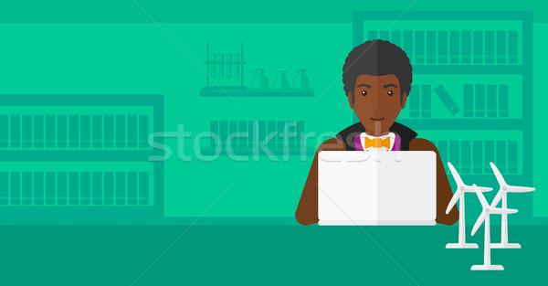 Man working at laptop.  Stock photo © RAStudio