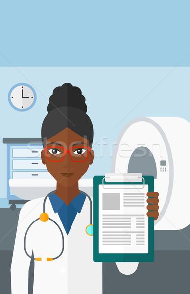 Doctor in hospital room with MRI machine. Stock photo © RAStudio