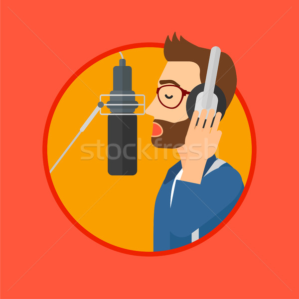 énekes dal fiatalember fejhallgató énekel zenei stúdió Stock fotó © RAStudio
