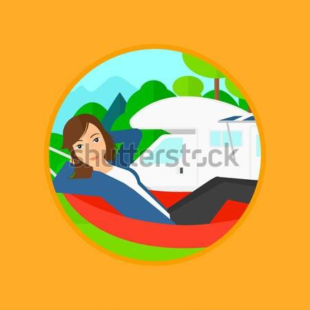 Woman lying in hammock in front of motor home. Stock photo © RAStudio