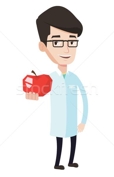 Voedingsdeskundige aanbieden vers rode appel jonge kaukasisch Stockfoto © RAStudio