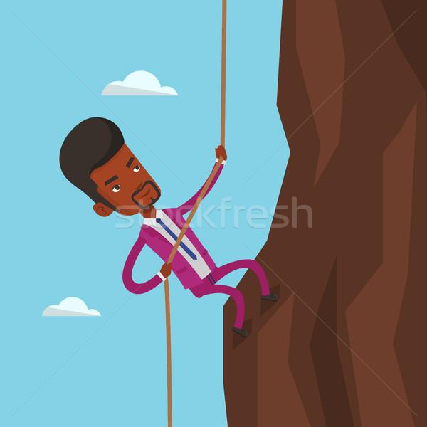 Businessman climbing on the mountain. Stock photo © RAStudio