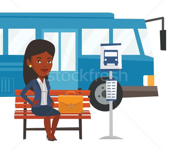 Iş kadını bekleme otobüs durağı Afrika kadın evrak çantası Stok fotoğraf © RAStudio