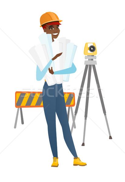 Engineer holding twisted blueprints. Stock photo © RAStudio