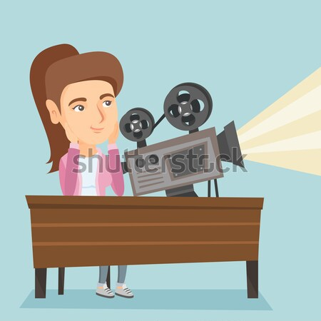 Asian projectionist showing new film. Stock photo © RAStudio