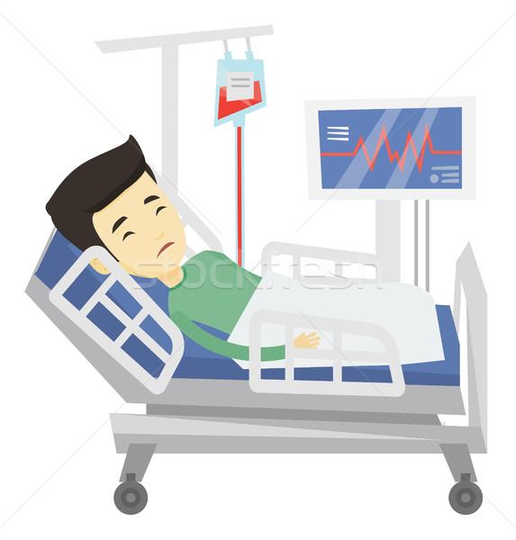 Férfi kórházi ágy fiatal ázsiai beteg pihen Stock fotó © RAStudio