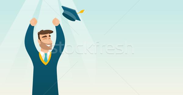 Afgestudeerde omhoog afstuderen hoed gelukkig Stockfoto © RAStudio