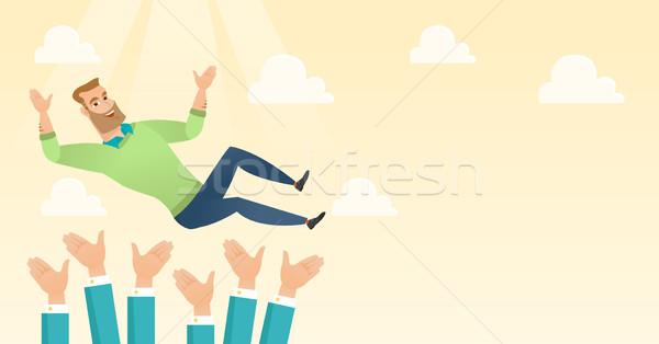 Successful businessman during celebration. Stock photo © RAStudio