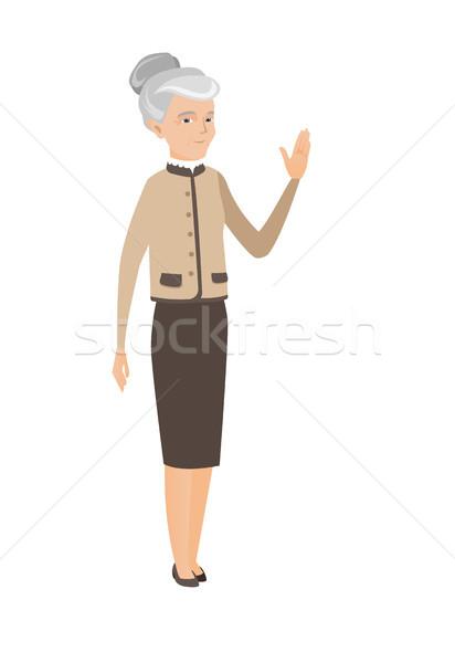 Senior caucasian business woman waving hand. Stock photo © RAStudio