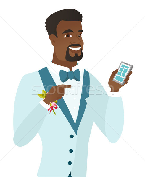 African-american groom holding a mobile phone. Stock photo © RAStudio
