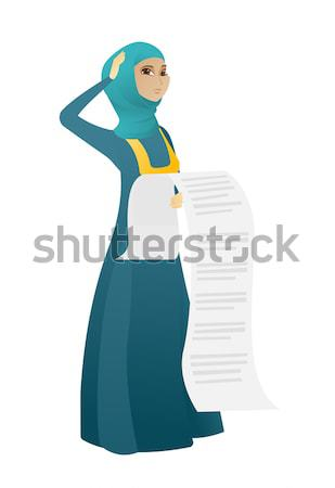 Smiling business woman holding tablet computer. Stock photo © RAStudio