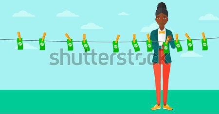 Woman loundering money vector illustration. Stock photo © RAStudio