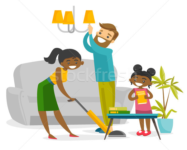 Young happy multiracial family cleaning house. Stock photo © RAStudio