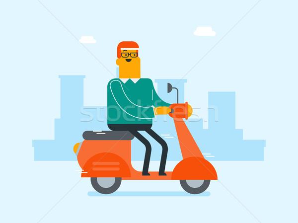 Young caucasian white man riding a scooter. Stock photo © RAStudio