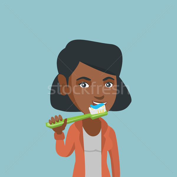 Young african-american woman brushing teeth. Stock photo © RAStudio