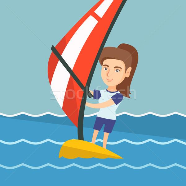 Fiatal kaukázusi nő windszörf tenger áll Stock fotó © RAStudio