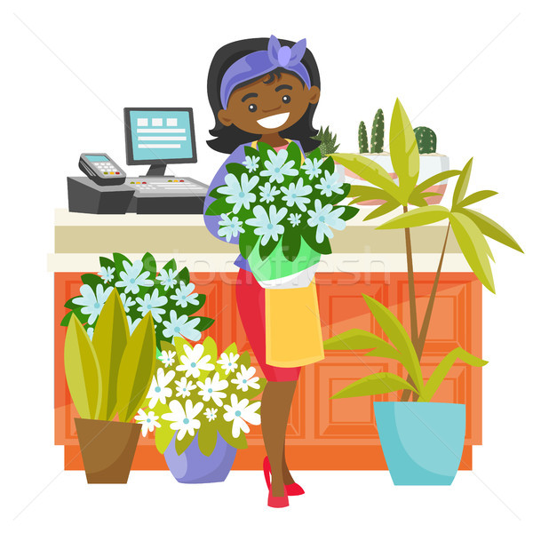 Business owner holding a bouquet in a flower shop. Stock photo © RAStudio