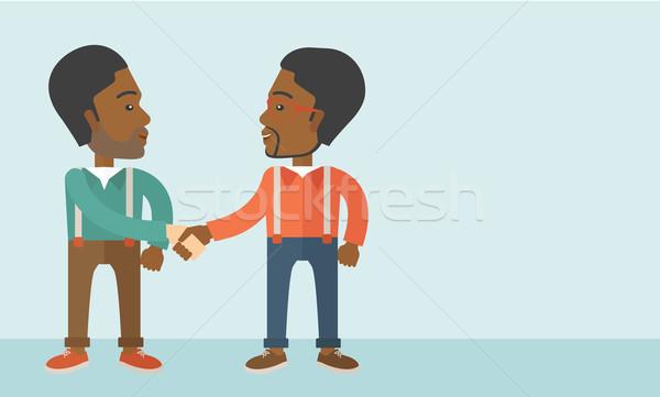 Two African-american guys happily handshaking. Stock photo © RAStudio