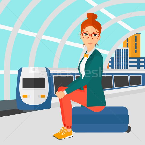 Donna seduta ferrovia moderno treno Foto d'archivio © RAStudio