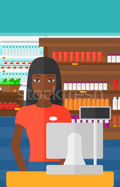 Saleslady standing at checkout. Stock photo © RAStudio