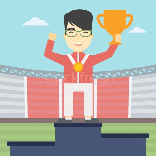 Sportowiec zwycięzcy podium asian młody człowiek Zdjęcia stock © RAStudio