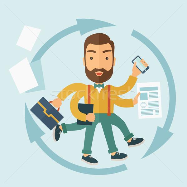 The Man Capable of Multitasking. Stock photo © RAStudio
