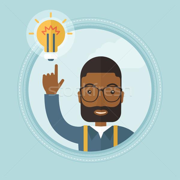 Сток-фото: бизнесмен · бизнеса · Идея · возбужденный · указывая · лампа