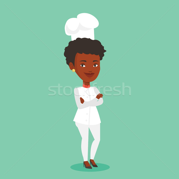 Confident female chief cook with arms crossed. Stock photo © RAStudio