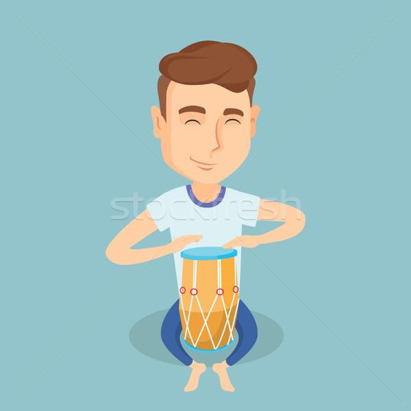 Homem jogar étnico tambor caucasiano moço Foto stock © RAStudio