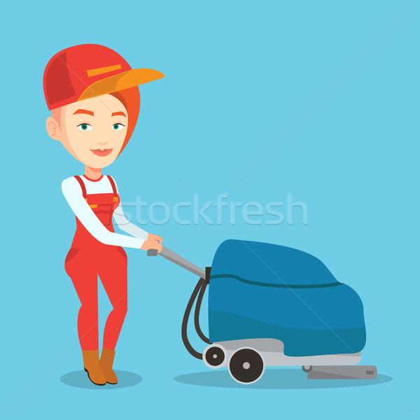 Female worker cleaning store floor with machine. Stock photo © RAStudio