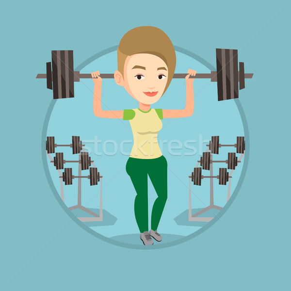 Vrouw barbell zwaar gewicht sterke Stockfoto © RAStudio