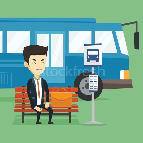 Business man waiting at the bus stop. Stock photo © RAStudio