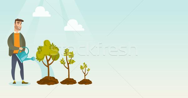 üzletasszony locsol fák kaukázusi üzlet befektető Stock fotó © RAStudio